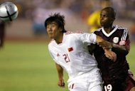 Former national squad player Li Ming (L) at the 2004 Asian Cup in Beijing. Li is accused of taking bribes to fix a 2003 Chinese domestic league game in which his team, Shanghai Guoji, lost 2-1 to Tianjin Teda, Xinhua said