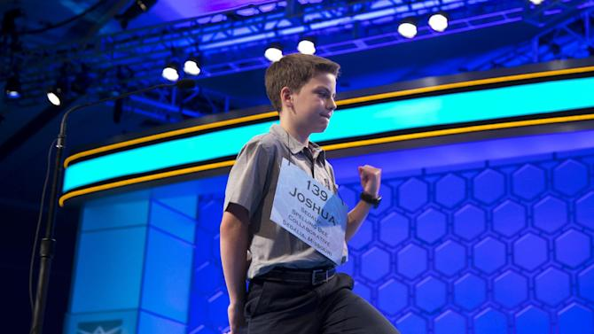 """Joshua Sturgill of Sedalia, Mo., pumps his fist after getting the word """"aggrandizement"""" correct during the third round of the National Spelling Bee, Wednesday, May 29, 2013, in Oxon Hill, Md. (AP Photo/Evan Vucci)"""