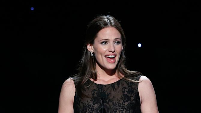 IMAGE DISTRIBUTED FOR THE PRODUCERS GUILD - Jennifer Garner presents an award at the 24th Annual Producers Guild (PGA) Awards at the Beverly Hilton Hotel on Saturday Jan. 26, 2013, in Beverly Hills, Calif. (Photo by Todd Williamson/Invision for The Producers Guild/AP Images)