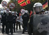 Riot police line up in front of a far-right group Pro Deutschland demonstration in Berlin. German politicians and Muslim groups are agonising over whether to ban a small far-right group from screening in public an anti-Islam film that has sparked violent protests from Pakistan to Sudan