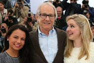 "British actresses Siobhan Reilly and Jasmin Riggins (L) pose with British director Ken Loach during the photocall of ""The Angel's Share"" presented in competion at the 65th Cannes film festival"