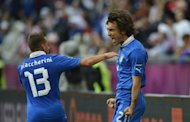 Italy's Andrea Pirlo (R) celebrates with teammate Emanuele Giaccherini after scoring during the Euro 2012 match against Croatia on June 14. Italy's preparation for their final Group C clash against Ireland on Monday is at risk of being derailed by a biscuit