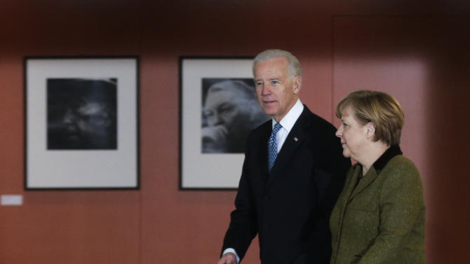 German Chancellor Angela Merkel, right, walks with United States' Vice President Joe Biden for a meeting at the chancellery in Berlin, Germany, Friday, Feb. 1, 2013. (AP Photo/Markus Schreiber)