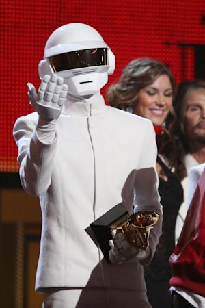 """Thomas Bangalter, of Daft Punk, accepts the award for record of the year for """"Get Lucky"""" at the 56th annual Grammy Awards at Staples Center on Sunday, Jan. 26, 2014, in Los Angeles. (Photo by Matt Sayles/Invision/AP)"""