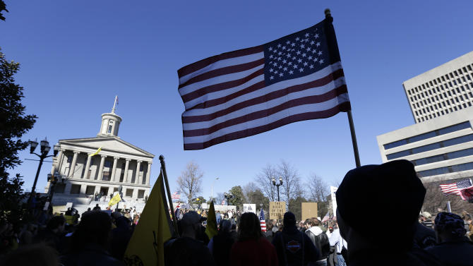 """Gun rights advocates demonstrate near the Capitol building on Saturday, Jan. 19, 2013, in Nashville, Tenn. Supporters of gun rights held """"Guns Across America"""" rallies across the country Saturday in response to President Barack Obama's plan to curb gun violence. (AP Photo/Mark Humphrey)"""