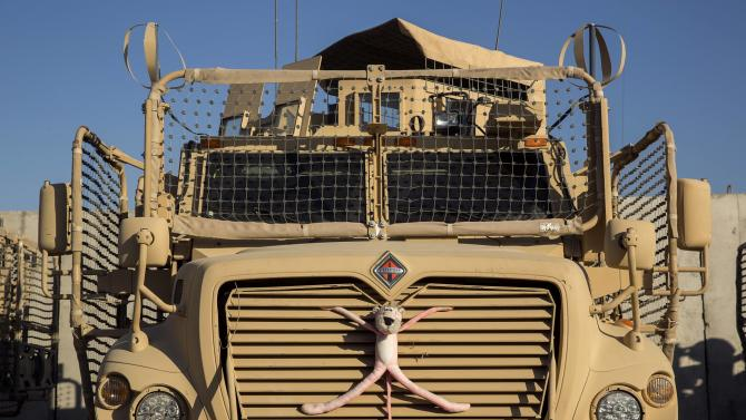 A stuffed animal is strapped to the front of an MRAP vehicle belonging to Dragon Company of the 3rd Cavalry Regiment on forward operating base Gamberi in the Laghman province of Afghanistan