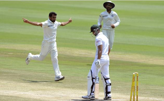 India's Mohammed Shami celebrates after bowling out South Africa's Petersen during the final day of their cricket test match in Johannesburg