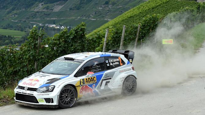 Finish driver Jari-Matti Latvala and his compatriot co-driver Mikka Anttila steer their Volkswagen Polo R WRC as they compete during the FIA World Rally Championship of Germany in Trier, on August 22, 2014