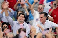 "Republican presidential candidate Mitt Romney and vice presidential candidate and Wisconsin native Rep. Paul Ryan greet supporters during a campaign event on August 12, 2012 in Waukesha, Wisconsin. Romney vowed to restore American strength and avert ""fiscal calamity"", as his re-energized presidential campaign drew a furious Democratic response"
