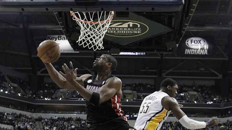 Miami Heat's Dwyane Wade (3) puts up a shot against Indiana Pacers' Roy Hibbert (55) during the first half of an NBA basketball game Tuesday, Jan. 8, 2013, in Indianapolis. (AP Photo/Darron Cummings)