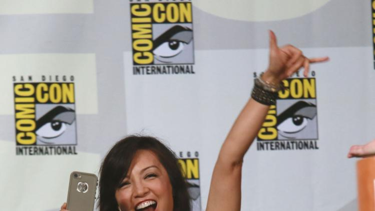 "Actress Ming-Na Wen waves to fans during the ""Marvel's Agents of S.H.I.E.L.D"" panel at the 2014 Comic-Con International Convention in San Diego"