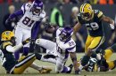 Minnesota Vikings' Adrian Peterson is brought down by Green Bay Packers' Brad Jones during their NFL NFC wildcard playoff football game in Green Bay