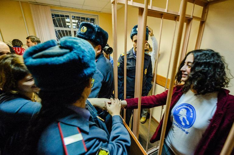 "A photo issued by Greenpeace on November 21, 2013 shows ""Arctic 30"" activist Gizem Akhan (R) from Turkey, in court in Saint Petersburg, Russia"