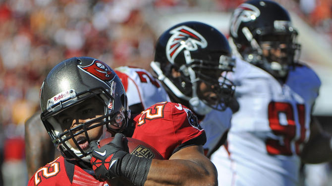 Tampa Bay Buccaneers running back Doug Martin (22) gets past the Atlanta Falcons defense to score a touchdown during the first quarter of an NFL football game Sunday, Nov. 25, 2012, in Tampa, Fla. (AP Photo/Brian Blanco)