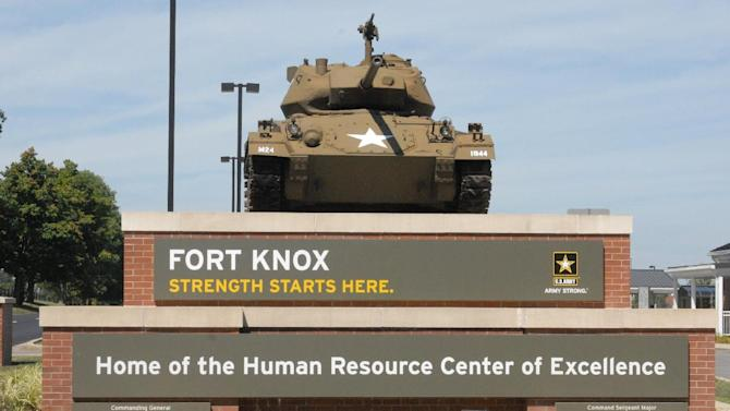 This Aug. 18, 2010 image provided by the U.S. Army shows the Chaffee Gate entrance to Fort Knox. An Army civilian employee was shot and killed in a parking lot at Kentucky's Fort Knox on Wednesday, and investigators were seeking to question a man in connection with the shooting, authorities said. Army officials said in a news release late Wednesday April 3, 2013 that the victim was an employee of the U.S. Army Human Resources Command, which handles personnel actions for soldiers. The shooting occurred in a lot outside the command. The victim was transported to the Ireland Army Community Hospital where he was pronounced dead. (AP Photo/US Army)
