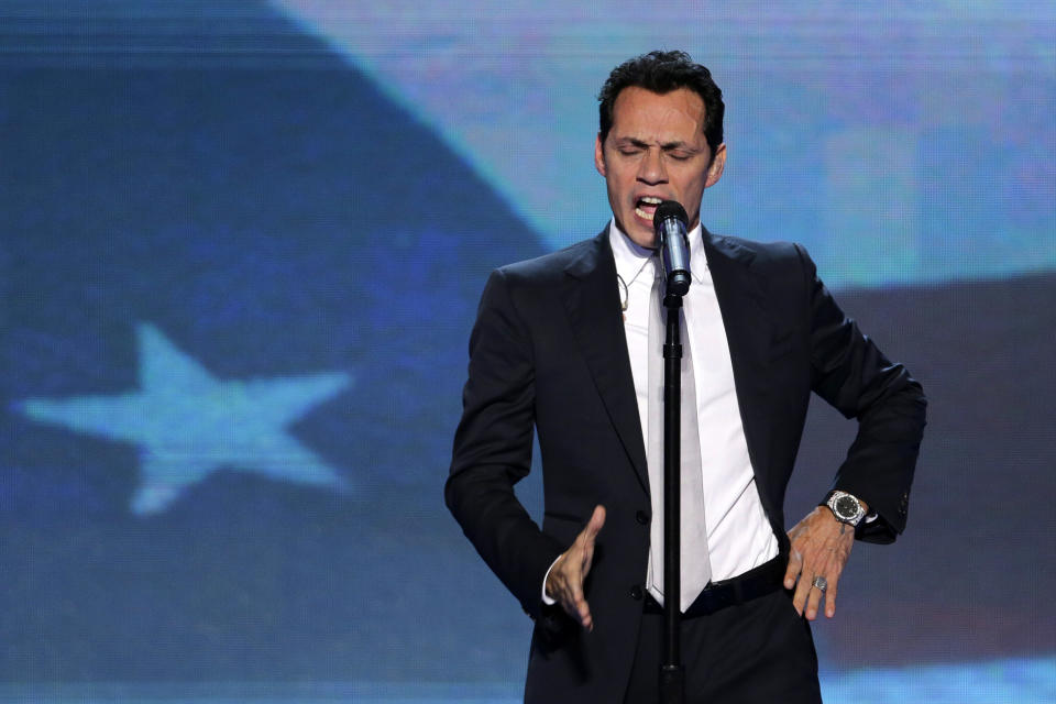 Singer Marc Anthony sings the National Anthem during the Democratic National Convention in Charlotte, N.C., on Thursday, Sept. 6, 2012. (AP Photo/J. Scott Applewhite)