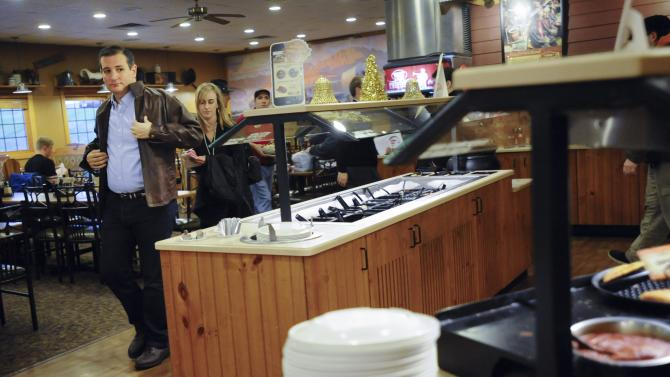 U.S. Republican presidential candidate Cruz leaves a campaign stop at a Pizza Ranch in Newton, Iowa
