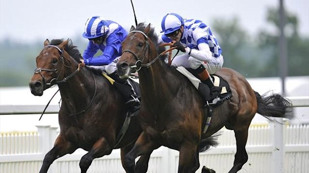 James Doyle on his mount Al Kazeem (R) wins the Prince of Wales's Stakes at Royal Ascot (Reuters)