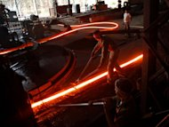 Indian labourers work at a steel factory in the outskirts of Agartala, in the northeastern state of Tripura on November 1, 2012. India's government is to sell a stake in state-run steel giant SAIL, the steel ministry said on Wednesday, as part of an ambitious disinvestment plan to reduce the country's deficit
