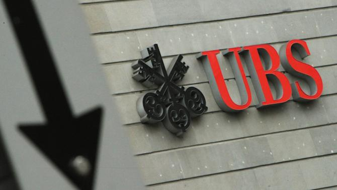 FILE -In this Jan. 24, 2013 file photo the logo of Swiss bank UBS is pictured in Zurich, Switzerland. Switzerland's biggest bank UBS AG posted Tuesday, Feb. 5, 2013, a 1.9 billion francs (US dollar 2.1 billion) loss for the fourth quarter in the wake of a series of lawsuits, scandals and a wave of restructuring. The bank ended 2012 with a loss of more than 2.2 billion francs (US dollar 2.4 billion), compared with a profit of 4.4 billion francs for 2011. (AP Photo/Keystone, Steffen Schmidt, File)