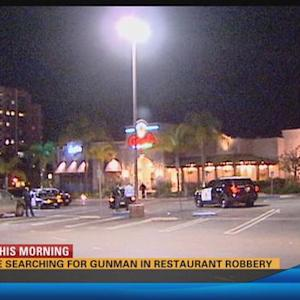 Police searching for gunman in restaurant robbery  4:30 a.m.
