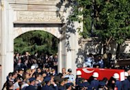 Turkish soldiers carry a coffin with the remains of a pilot of a fighter jet shot down by Syria last month. Turkish leaders observed a minute's silence Friday in tribute to the two-man crew of the warplane