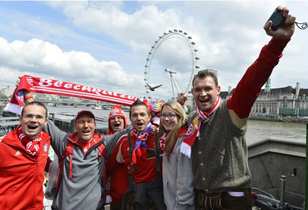 Bayern Munich supporters sing as they walk near the London Eye in central London