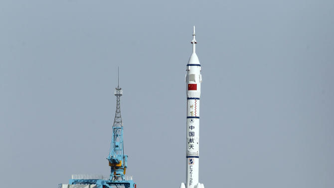 Shenzhou 9 spacecraft rocket launches from the Jiuquan Satellite Launch Center in Jiuquan, China, Saturday, June 16, 2012. China sent its first woman and two other astronauts into space Saturday to work on a temporary space station for about a week, in a key step toward becoming only the third nation to set up a permanent base in orbit. (AP Photo/Ng Han Guan)