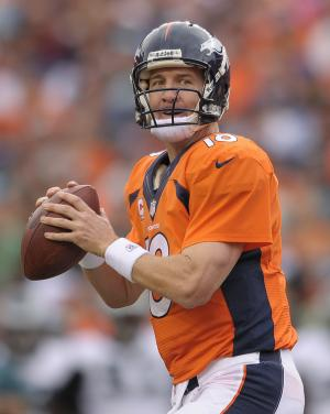 Denver Broncos quarterback Peyton Manning (18) drops back to pass for a touchdown to Wes Welker against the Philadelphia Eagles in the third quarter of an NFL football game, Sunday, Sept. 29, 2013, in Denver. (AP Photo/Jack Dempsey)