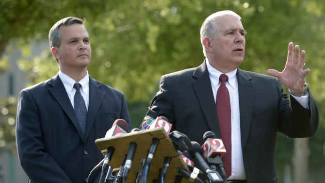 Hal Uhrig, right, and Craig Sonner, former attorneys for George Zimmerman, speak to reporters during a news conference to announce that both attorneys had quit as Zimmerman's legal representatives in Sanford, Fla., Tuesday, April 10, 2012. Zimmerman is a neighborhood watch volunteer who authorities say fatally shot an unarmed teenager. The men said have withdrawn as his counsel because they haven't heard from him in days and he is taking actions related to the case without consulting them. (AP Photo/Phelan M. Ebenhack)
