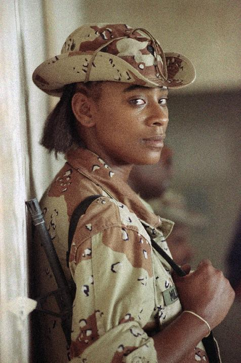 FILE - In this Sunday, Sept. 3, 1990 file photo, U.S. Army Spec.Tanya Miller of New York., leans against a wall on an airbase in Saudi Arabia. Miller was in Saudi Arabia with the 101st Airborne Divsion in support of Operation Desert Shield. (AP Photo/David Longstreath, File)