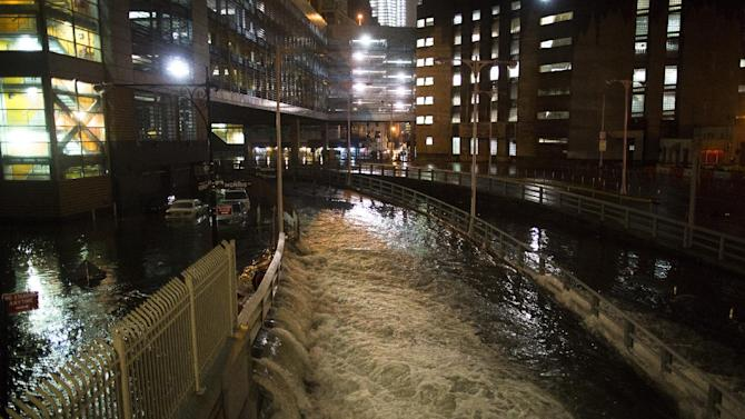 FILE - In this Oct. 29, 2012 file photo, sea water floods the entrance to the Brooklyn Battery Tunnel in New York during Superstorm Sandy. Floodgates for tunnels, subways and airports as well as a network of safe havens like old Civil Defense shelters should be among quick, simple preventive measures that New York installs ahead of future storms, according to the full report by an expert panel examining Superstorm Sandy's effects in the state. (AP Photo/ John Minchillo, File)