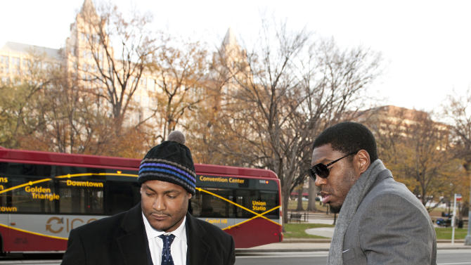 New Orleans Saints football defensive end Will Smith, left, and linebacker Jonathan Vilma arrive at an attorney's office in Washington, Friday, Nov. 30, 2012, for a hearing on their appeals of bounties suspensions. Friday's session is part of the latest round of player appeals overseen by former NFL Commissioner Paul Tagliabue.  (AP Photo/Cliff Owen)