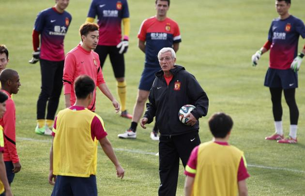 Marcello Lippi, coach of China's Guangzhou Evergrande, takes part in a training session in Agadir Stadium, Agadir