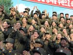 North Korean soldiers applaud as North Korean leader Kim Jong-Un visits a sub-unit under the Korean People's Army Unit 552 in this undated picture released by the North's official KCNA news agency ...