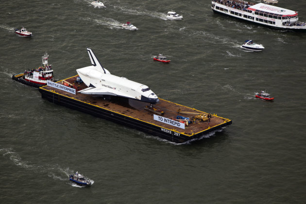 The Space Shuttle Enterprise floats up the Hudson River