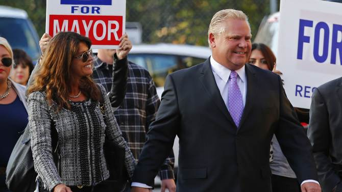 Toronto mayoral candidate Ford arrives with his wife Karla before a municipal debate for the upcoming city election in Toronto