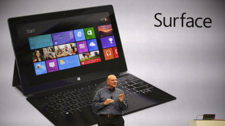 "Microsoft CEO Steve Ballmer unveils ""Surface"", a new tablet computer to compete with Apple's iPad, at Hollywood's Milk Studios in Los Angeles Monday, June 18, 2012. The 9.3 millimeter thick tablet comes with a kickstand to hold it upright and keyboard that is part of the device's cover. It weighs under 1.5 pounds. (AP Photo/Damian Dovarganes)"