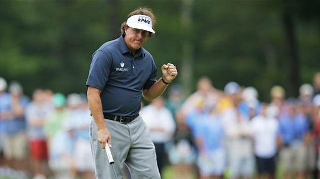 Phil Mickelson pumps his fist after a birdie on the 14th hole during the first round of the Deutsche Bank Championship in Norton, Massachusetts August 30, 2013 (Reuters)