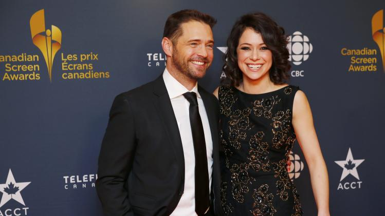Actor Jason Priestly and actress Tatiana Maslany arrive on the red carpet at the 2014 Canadian Screen awards in Toronto