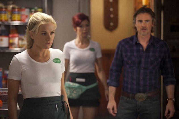 "This image released by HBO shows, from left, Anna Paquin as Sookie Stackhouse, Carrie Preston as Arlene Fowler, Sam Trammell as Sam Merlotte in a scene from ""True Blood."" Recipes by Marcelle Bienvenu, inspired by the popular supernatural series, have been gathered in a book ""True Blood: East, Drinks, and Bites from Bon Temps."" (AP Photo/HBO)"