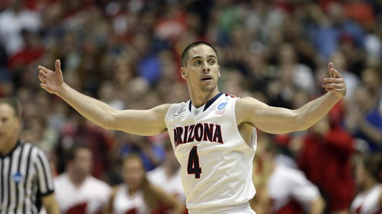 Arizona's T.J. McConnell reacts during the second half in a regional final NCAA college basketball tournament game against Wisconsin, Saturday, March 29, 2014, in Anaheim, Calif
