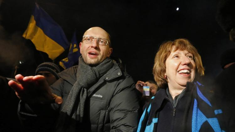 European Union foreign policy chief Ashton walks with former economy minister and head of the union of Ukrainian opposition parties Yatsenyuk along Independence Square in Kiev