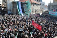 Anti-Syrian regime protesters gather at a square as they hold an Arabic banner, center, reading, &quot;hey, the miserable, the tyrant, what else,&quot; during a demonstration at the mountain resort town of Zabadani, Syria, near the Lebanese border, on Friday Jan. 20, 2012. President Bashar Assad&#39;s forces attacked Zabadani, some 17 miles (27 kilometers) west of the capital, for six days, sparking fierce fighting that involved heavy bombardments and clashes with army defectors. On Wednesday, government tanks and armored vehicles pulled back, leaving the opposition in control of the town. Buoyed by the opposition&#39;s control of a town near the Syrian capital, thousands of people held anti-government protests Friday, chanting for the downfall of the regime. At least eight people were killed by security forces across the country, activists said. (AP Photo)