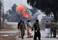 Troops detonate a bomb that failed to go off during an assault by militants near Peshawar airport in northwest Pakistan on December 16, 2012. Six people were killed Sunday as police and troops battled militants armed with automatic weapons, grenades and mortars in Peshawar, a day after a deadly Taliban raid on the city&#39;s airport