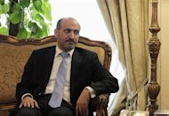 President of the Syrian National Coalition Ahmad Al-Jarba looks on during his meeting with Egypt's Foreign Minister Nabil Fahmy (not pictured) in Cairo, November 26, 2013. REUTERS/Mohamed Abd El Ghany