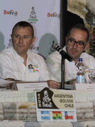 Dakar Rally Director Etienne Lavigne (L) and Coordinator Gregory Murac attend a ceremony in La Paz April 16, 2013. According to local media, Dakar Rally 2014 will pass through Bolivia, along with Chile and Argentina, for the first time. REUTERS/David Mercado (BOLIVIA - Tags: SPORT MOTORSPORT)