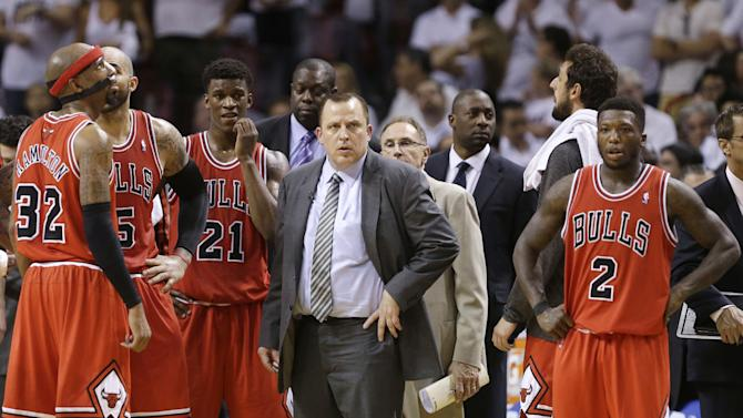 Chicago Bulls coach Tom Thibodeau, center, and players wait for officials to make a video review during the second half of Game 5 of the Bulls' NBA basketball playoff series in the Eastern Conference semifinals against the Miami Heat, Wednesday, May 15, 2013, in Miami. The Heat defeated the Bulls 94-91 and advanced to the conference finals. (AP Photo/Wilfredo Lee)