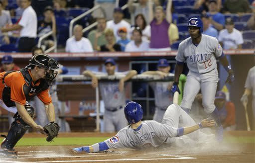 Stanton homers twice to help Marlins beat Cubs 6-4