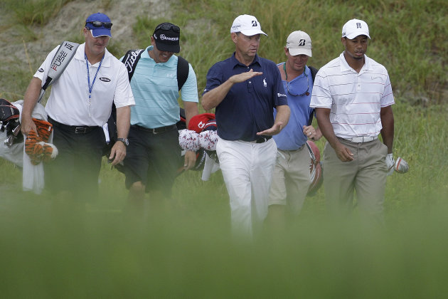 Davis Love III gestures as he walks with Tiger Woods, right, down the 13th hole during a practice round for the PGA Championship golf tournament on the Ocean Course of the Kiawah Island Golf Resort in Kiawah Island, S.C., Wednesday, Aug. 8, 2012. (AP Photo/Chuck Burton)